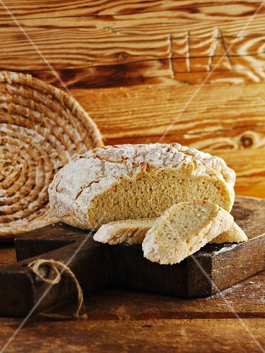 Rustic French bread, partly sliced