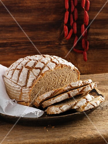 Rustic white bread, partly sliced