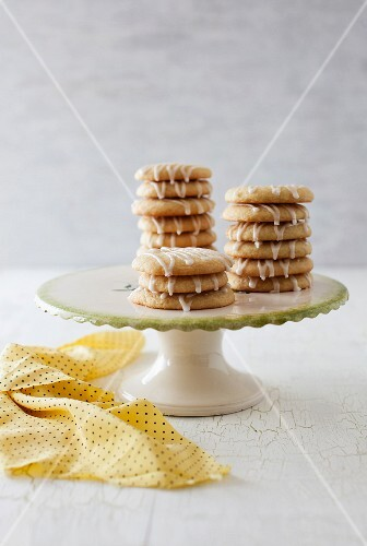 Glazed lemon biscuits on a cake stand