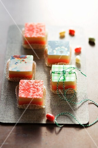 Petits fours topped with patterned sugar glaze