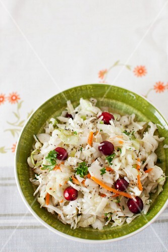 Cole Slaw with Cranberries in a Green Bowl