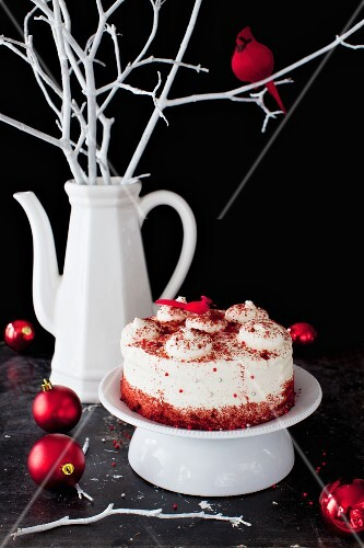 Red Velvet Cake on a Pedestal Dish with Christmas Ornaments