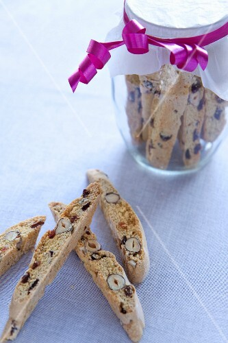 Biscotti, some in a storage jar
