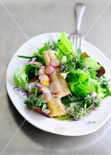 Colourful salad with smoked eel and edible flowers