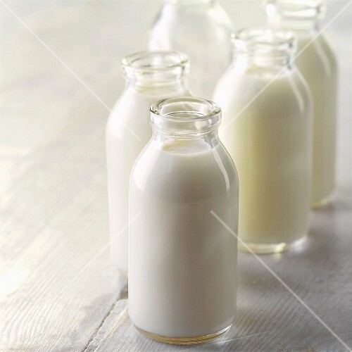Full and empty milk bottles