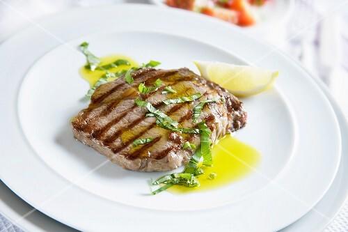 Griddled Rib Eye steak served with garlic infused olive oil and shredded basil.