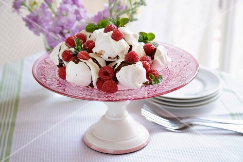 Mini meringues and Belgian chocolate, with whipped cream and raspberries