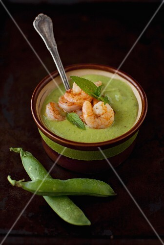 A Bowl of Green Pea and Mint Soup with Shrimp