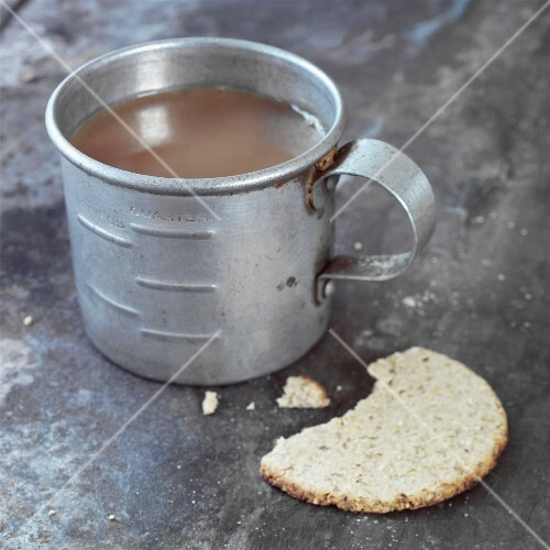 Tea in old zinc cup