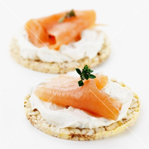 Smoked salmon and cream cheese on rice crackers