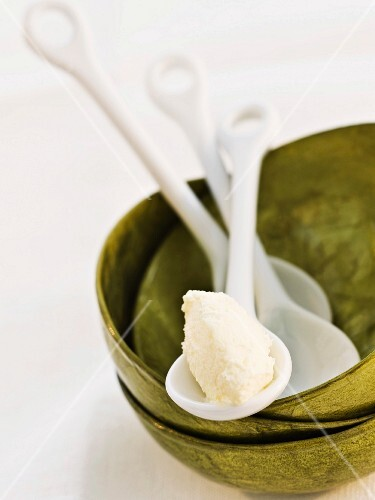 Double cream on a porcelain spoon