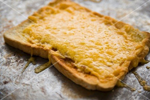 snack, savoury, cheese, cheese on toast, prepared, one, portion, slice, hot, melt, melted, melted cheese, oven tray, close up, golden, bubbling, cheeses, snacks, portions, slices