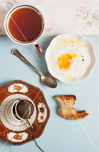 Hot tea with fried egg and toast