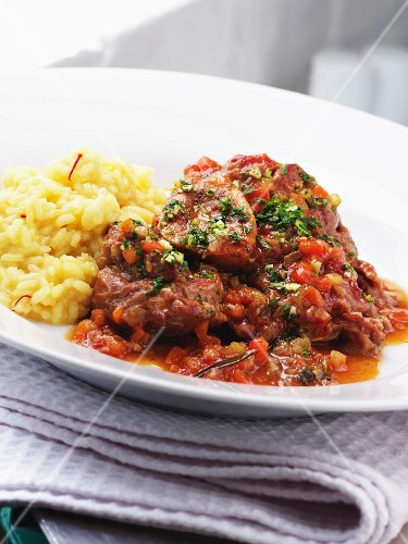 Osso buco (stewed cross-cut veal shin) with saffron risotto (Italy)
