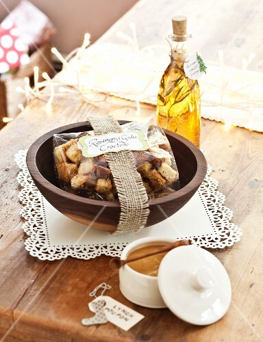 Homemade Rosemary Garlic Croutons in a Bag in a Wooden Bowl