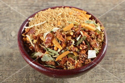 Couscous and ingredients in a bowl