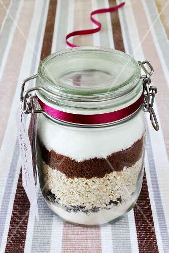 A preserving jar containing dry ingredients for making oat and raisin biscuits