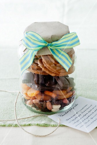 A jar containing dry ingredients for making chocolate tiffin