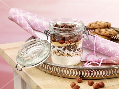 A jar containing dry ingredients for making hazelnut and chocolate biscuits