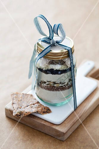 Wholegrain crackers and a jar containing ingredients for making them