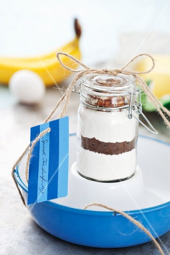 A jar containing dry ingredients for making banana bread