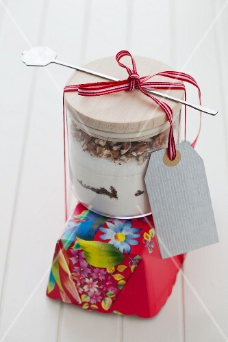 A jar containing dry ingredients for making carrot cake