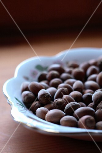 Hazelnuts in a porcelain dish