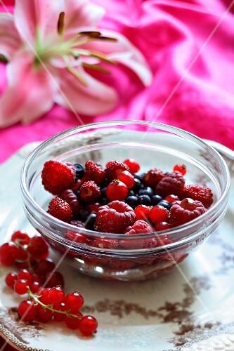Fresh berries in a glass dish