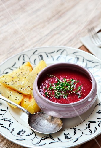 Beetroot cream soup with thyme and baked potatos
