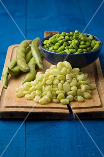 A still life featuring broad beans