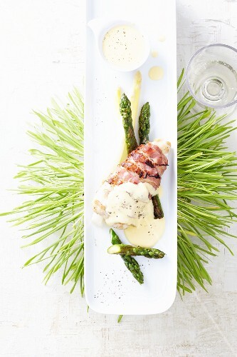 Hake wrapped in bacon with asparagus and hollandaise sauce