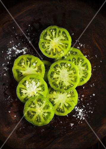 Green tomato slices with salt