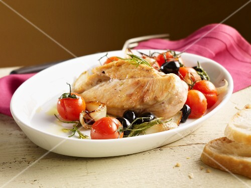 Chicken breast with tomatoes, olives, onions and rosemary