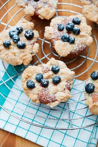 Blueberry muffins on a cake rack