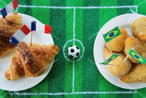 Croissants (France) and salgadinhos (Brazil) with football-themed decoration