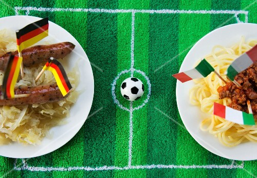 Sausages with cabbage (Germany) and spaghetti (Italy) with football-themed decoration