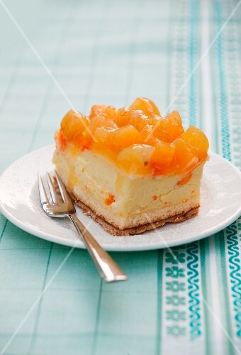 A piece of apricot cheesecake