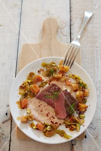 Saddle of lamb with root vegetables