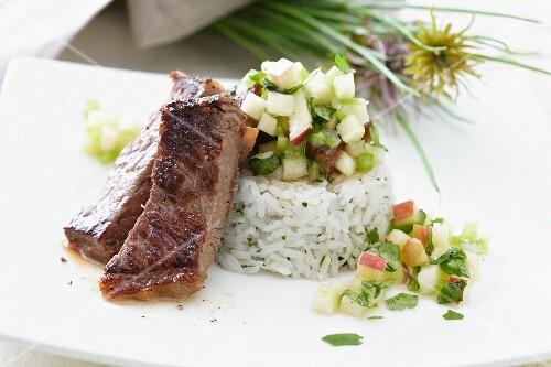 Rump steak with rice and apple salsa