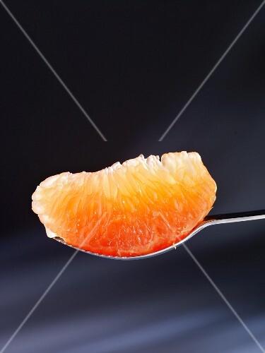 A segment of pink grapefruit