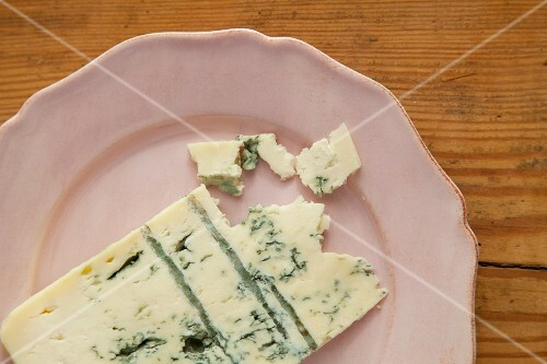 A slice of blue cheese on a plate