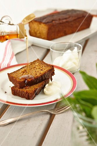 Sweet potato bread with nuts, being drizzled with maple syrup
