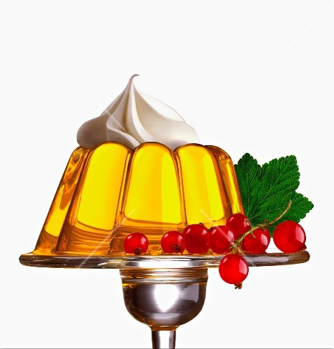 Golden jelly with a dab of whipped cream on top