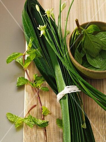 Fresh herbs on a wooden board