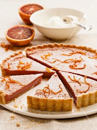 Blood orange tart with icing sugar