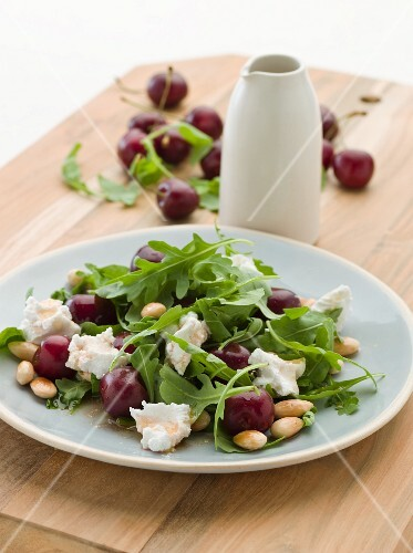 Rocket salad with cherries, feta and almonds