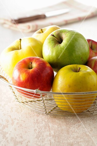 Assorted apples in a wire basket