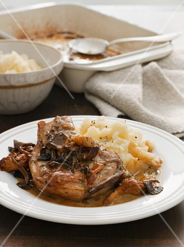 Pork chop with mashed potato and mushrooms
