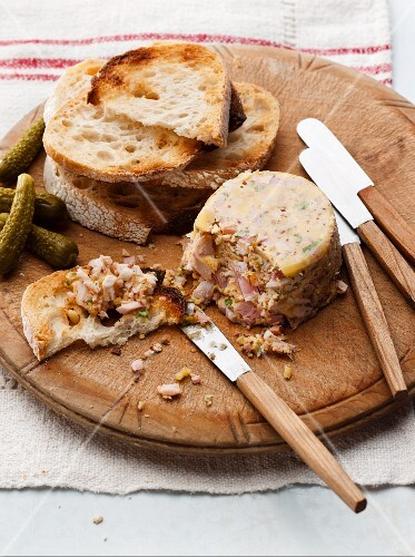 Turkey ham terrine with toasted bread and pickled gherkins