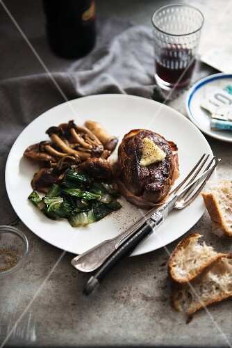 Beef steak with accompaniments, red wine and bread